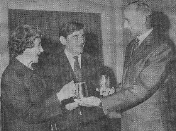Mrs Maude Blackburn & Mr Paddy Mahoney receive tankard presentations from President George Cross, 1973.