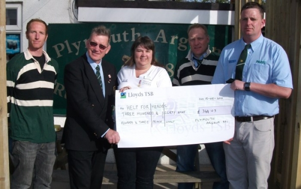 Chairman Chris Sillitoe presents the cheque to Help For Heroes aided by Mike Schaab, Mark Churchill and Paul Symons