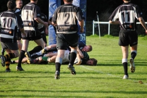 Chris Hamer squeezes over for a try